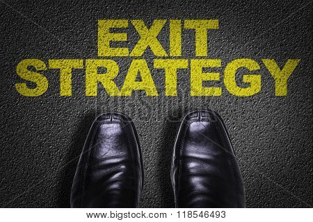 Top View of Business Shoes on the floor with the text: Exit Strategy