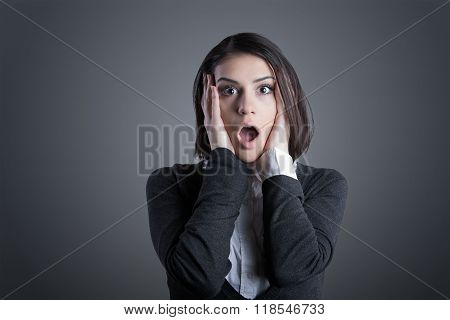 Excited woman looking surprised and amazed,speechless with mouth open