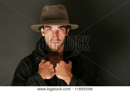 Attractive man with hat and trenchcoat