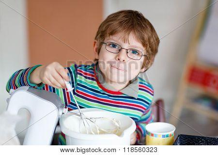 Funny Blond Kid Boy Baking Cake Indoors