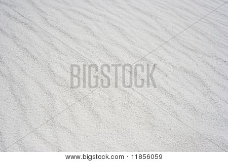 Rippled white sand textured background