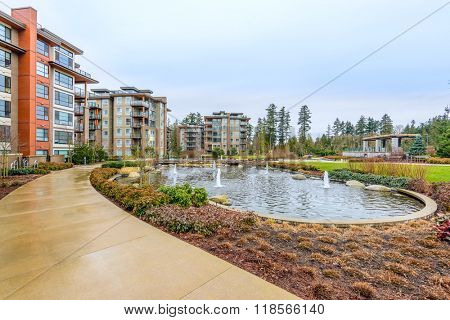 Modern apartment buildings with nice pond in Vancouver, British Columbia, Canada.
