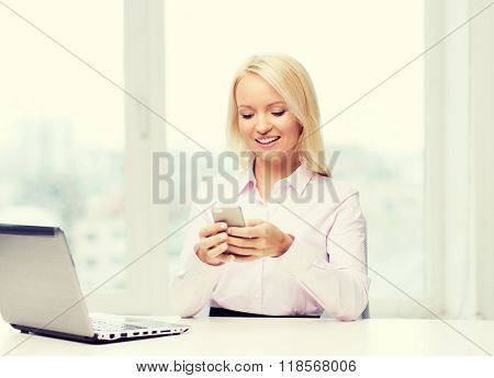 education, business, communication and technology concept - smiling businesswoman or student with smartphone texting message in office