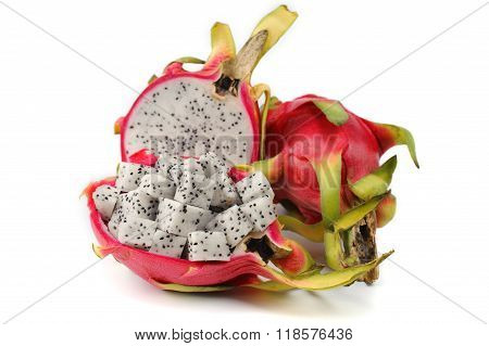 Close Up Diced Dragon Fruit Pieces In The Shell Next To A Whole