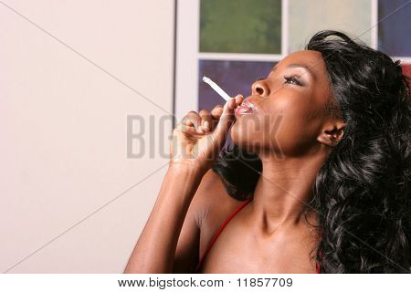 Beautiful sexy black woman smoking a cigarette poster