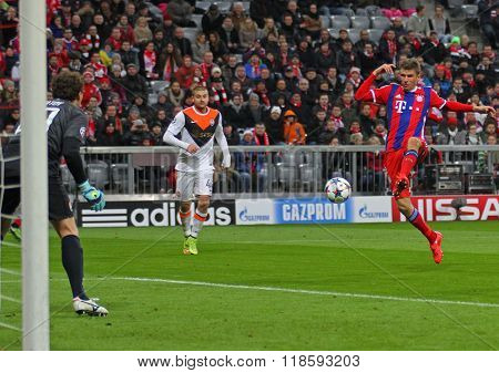 MUNICH, GERMANY - MARCH 11 2015: Bayern Munich's forward Thomas Muller takes a shot at goal during the UEFA Champions League match between Bayern Munich and FC Shakhtar Donetsk.