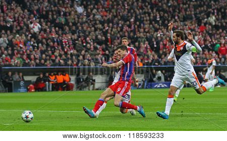 MUNICH, GERMANY - MARCH 11 2015: Bayern Munich's forward Robert Lewandowski scores a goal during the UEFA Champions League match between Bayern Munich and FC Shakhtar Donetsk.