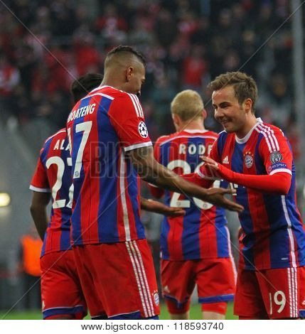 MUNICH, GERMANY - MARCH 11 2015: Bayern Munich's midfielder Mario G�¶tze celebrates scoring a goal with Bayern Munich's defender Jerome Boateng  during the UEFA Champions League match