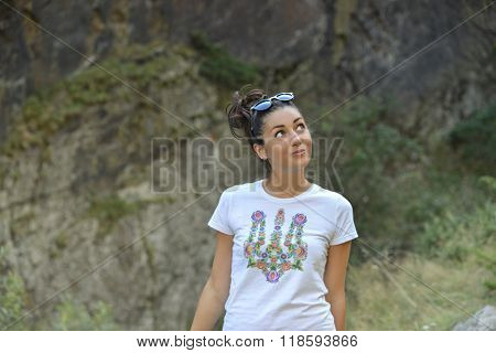 beautiful girl standing on mountain background