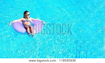 Girl In The Pool On An Inflatable Circle
