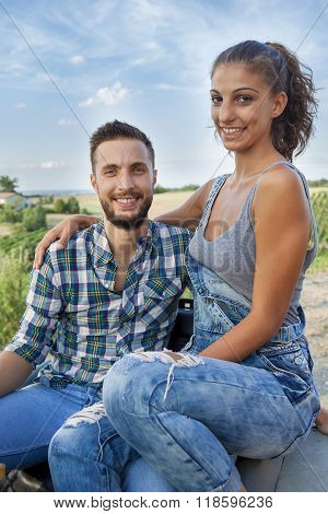 Young Couple Farmers Toasts In Their Vineyard