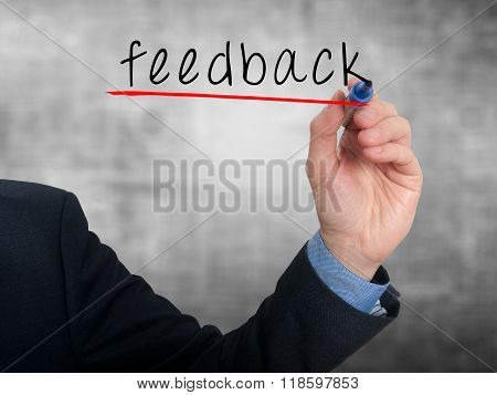 Businessman Hand Writing Feedback In The Air- Grey - Stock Photo