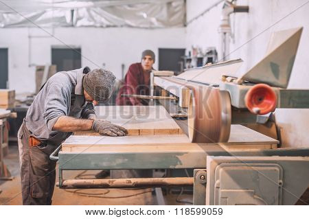 Carpenter using belt sander