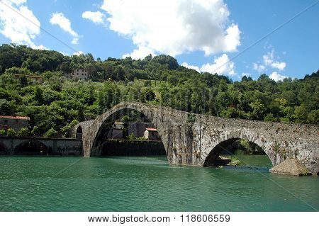 Picture of the bridge of Mary Magdalene near the town of Borgo a Mozzano in Italian province of Lucca. Also called the bridge of the devil. poster