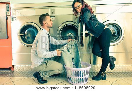 Young Attractive Couple Doing Laundry At Laundromat Shop - Boyfriend And Happy Girlfriend