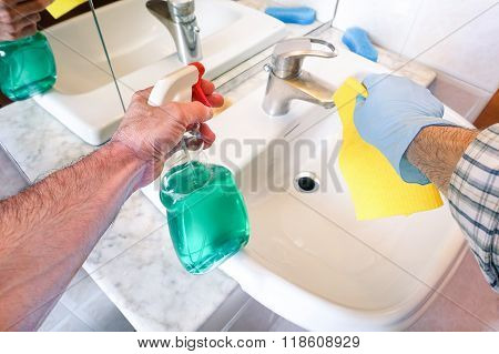 Man Hands Cleaning Washroom With Blue Sanitizer Product Wearing Glove And Holding Yellow Sponge