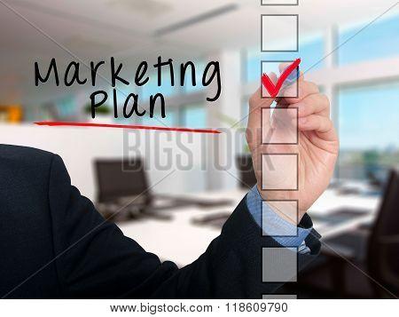 Businessman Hand Writing Marketing Plan And Check Listing Task