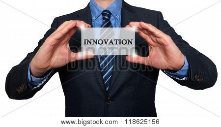 Businessman Holding White Card With Innovation Sign, White  - Stock Photo