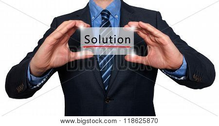 Businessman Holding White Card With Solution Sign, White - Stock Photo