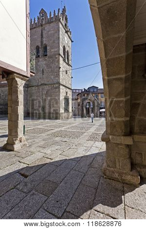 Guimaraes, Portugal - October, 2015: Nossa Senhora da Oliveira Church and Salado Monument in Oliveira Square seen through the old Town Hall arcade. Unesco World Heritage Site.
