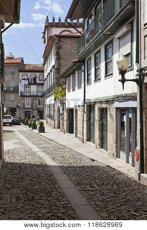Guimaraes, Portugal - April, 2015: Medieval street of the Historical Center of Guimaraes. UNESCO World Heritage Site.