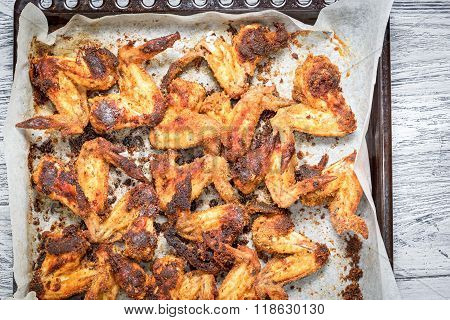 Chicken Wings On A Tray In The Kitchen Cooking A Delicious Dinner. Ready Meal With Crispy Crust. Cop