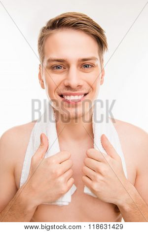 Portrait Of Cheerful Hansome Young Healthy Man With Towel On His Neck