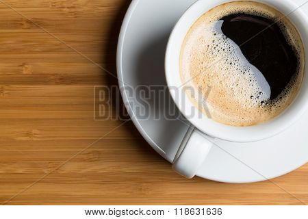 white cup of coffee on brown background