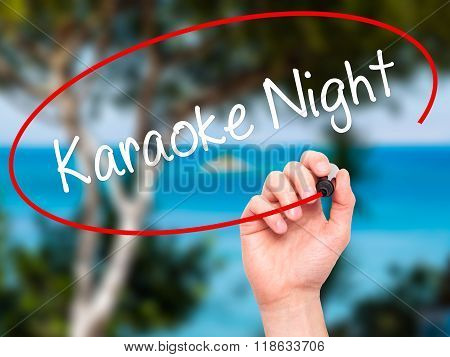 Man Hand Writing Karaoke Night With Black Marker On Visual Screen