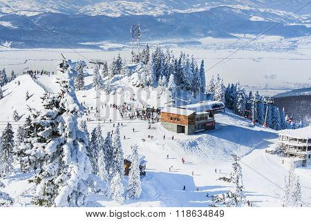 Group Of Tourists On A Ski Slope