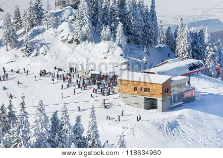 Group Of Tourists On A Ski Slope In Postavaru Mountain