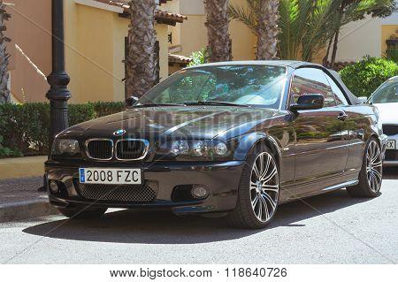 Black Modern Coupe-car Bmw 3 Series On Sunny Street, Torrevieja, Valencia, Spain