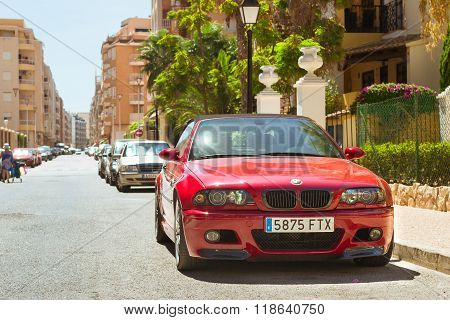 Red Modern Coupe-car Bmw M3 Series On Sunny Street, Torrevieja, Valencia, Spain