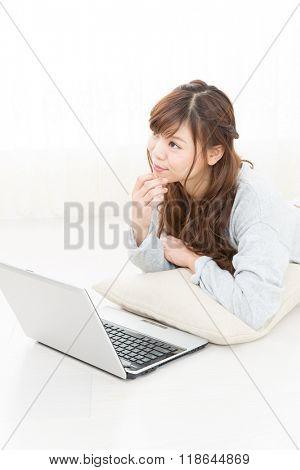 Beautiful young women using a laptop