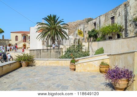 PREVELI, CRETE, Greece - AUGUST 21, 2013: Tourists visit Orthodox Moni Preveli monasteryi, located on Crete island