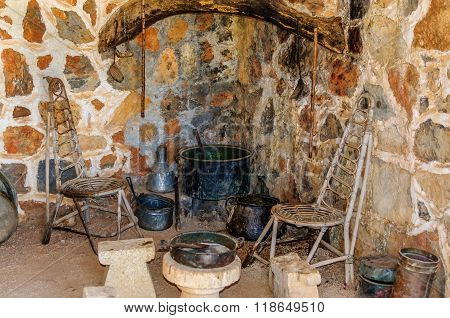LASSITHI, CRETE, GREECE - AUGUST 16, 2013: Interior of Homo sapiens kitchen in old house at Homo Sapiens museum on Crete island