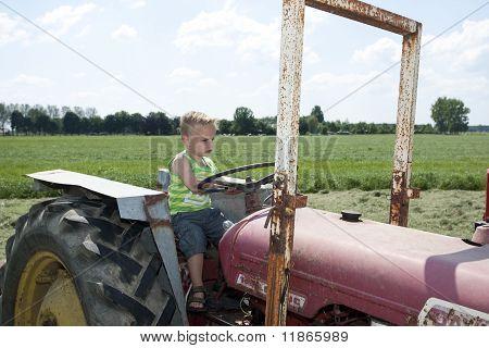 Young Man At A Farm Vehicle