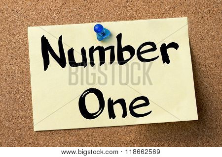 Number One - Adhesive Label Pinned On Bulletin Board