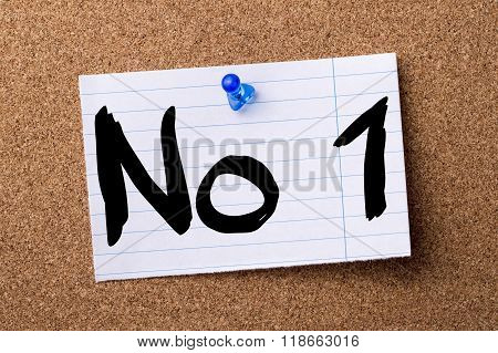 No1 - Teared Note Paper Pinned On Bulletin Board
