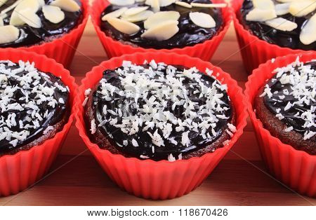 Chocolate Muffins With Desiccated Coconut And Sliced Almonds