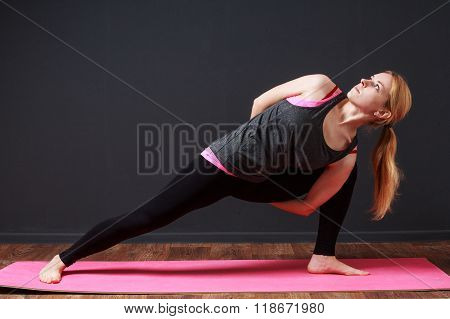 . Young Blonde Woman Doing Yoga Exercise