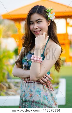 Young Cute Summer Girl On Green Grass Outside Relaxing Smiling