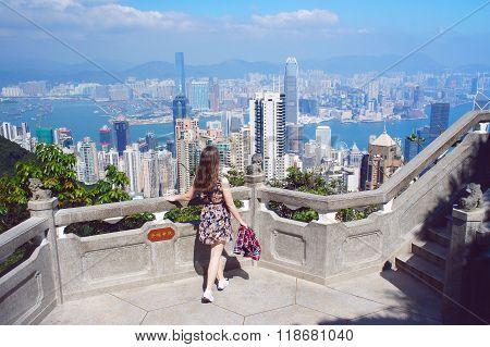 Girl Look At Hong Kong Buildings Panorama From Victoria Peak Park