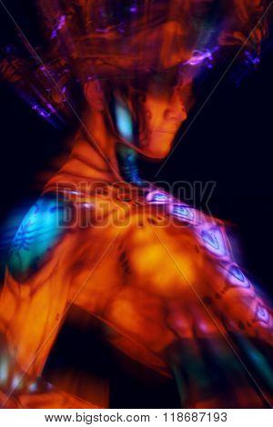 Freak girl in ultraviolet costume