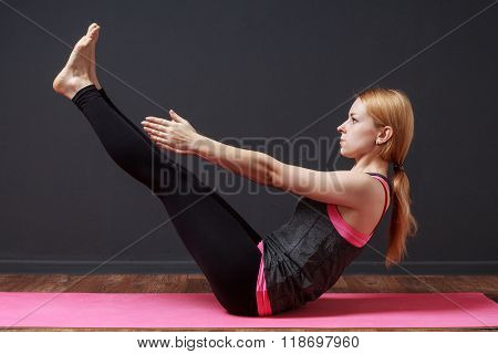 Full Boat Pose. Young Blonde Woman Doing Yoga Exercise