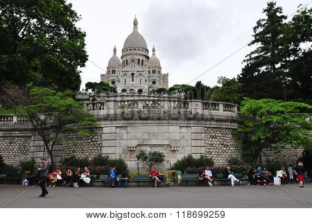 PARIS - JULY 5: Tourists stroll in Montmartre district on July 5 2013 in Paris France. Monmartre area is popular among tourists in Paris the most visited city worldwide.