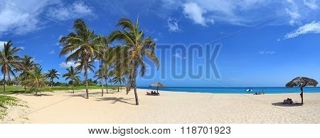 Caribbean tropical beach with beautiful white sand, turquoise water and palm trees in Tarara, Havana