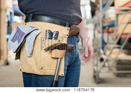 Workman with toolbelt