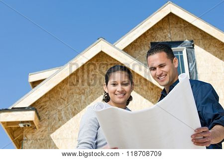 A couple looking at a blueprint