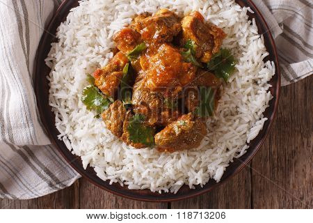 Beef Madras With Basmati Rice Close-up On A Plate. Horizontal Top View